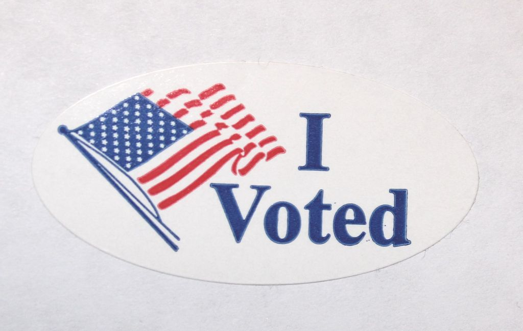 "Photo is of an ""I Voted"" sticker with an American flag."