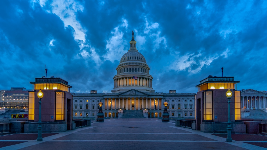 Photo is of the US Capitol in the evening.