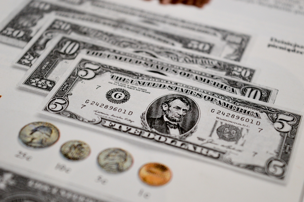 Photo is of American bills and cents.